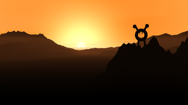 A wild lupi looks perchaes atop a mountain against a golden sunset.